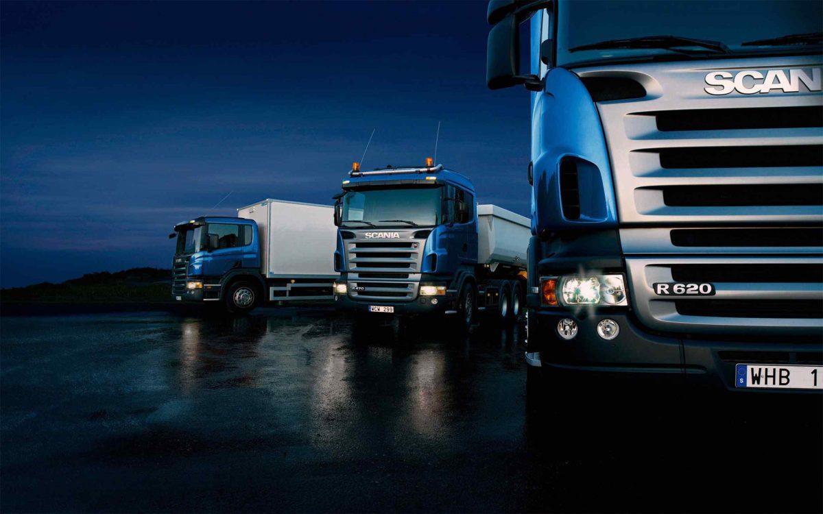 Three-trucks-on-blue-background-1200x750.jpg